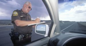 Police-officer-writing-a-ticket-Shutterstock-800x430